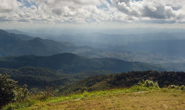 Grass, mountain and cloudy sky view of Chiangmai Thailands Royalty Free Stock Images
