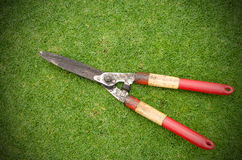 Grass  old scissors isolated Royalty Free Stock Images