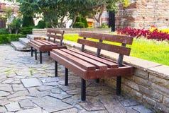 Grass park bench Royalty Free Stock Photos
