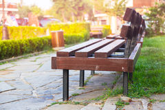 Grass park bench Stock Images