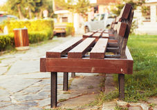 Grass park bench Royalty Free Stock Photography