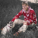 In the grass with pug dog_greenless Stock Image