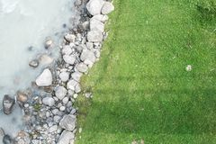 The grass and the rocks of the river Royalty Free Stock Photo