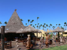 Grass roof restaurant and cafe. A Brazilian restaurant with a thatched grass roof and outdoor cafe Royalty Free Stock Photo