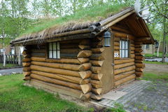A grass-roofed log cabin at chena, alaska. Royalty Free Stock Image