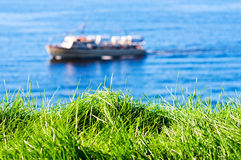 Grass with seas and boat on background. Oslo Norway Stock Photography