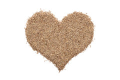 Grass seeds in a heart shape Royalty Free Stock Photos