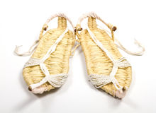 Grass shoes on white background Royalty Free Stock Photography