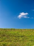 Grass and Sky. A hillside along the Great Miami River in Ohio Royalty Free Stock Photo