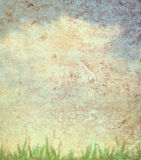 Grass and sky on paper texture Stock Images