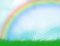 Grass, sky and rainbow_. Background of a summer landscape (grass, sky and rainbow Royalty Free Stock Image