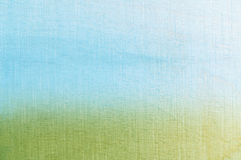Grass and Sky Textured Background. Woodgrain photograph tinted with blue and green colours, softly merging together at horizon to create an abstract painterly Stock Photos