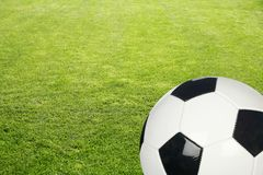 Grass with soccer ball. Grass field with black and white soccer ball background Stock Photos