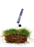 Grass and soil treatment Stock Image