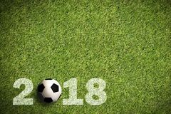 Grass with 2018 sprayed text and a soccer ball Stock Images