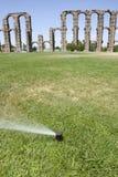 Grass Sprinklers wtih Roman Aqueduct. Of Merida at the bottom. Extremadura, Spain Stock Photos