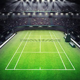 Grass tennis court and stadium full of spectators with spotlights Royalty Free Stock Images