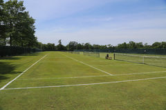 Grass tennis courts. In country club stock photos