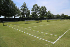 Grass tennis courts. In country club stock images
