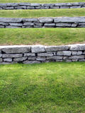Grass terraced. Gardening design with grass and stone wall terraced stock photography