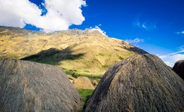 Grass thatched hut in peru. The grass thatched huts on the Salkantay trek in Peru South America Royalty Free Stock Images