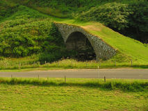 Grass Track Bridge. A traditionally stone built bridge with an unusual grass track over it Royalty Free Stock Image