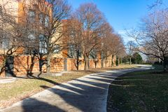 Grass and Tree Lined Path with Residential Buildings in Edgewater Chicago stock image