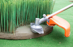 Grass trimmer mowing Royalty Free Stock Photo