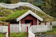 Grass turf used as roofing material on Norwegian stable. Grass and turf used as roofing material on Norwegian homes and stable stock photo
