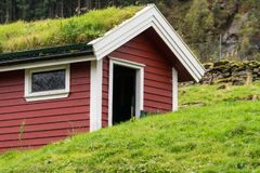 Grass turf used as roofing material on Norwegian stable. Grass and turf used as roofing material on Norwegian homes and stable royalty free stock photography