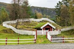 Grass turf used as roofing material on Norwegian stable. Grass and turf used as roofing material on Norwegian homes and stable royalty free stock photos