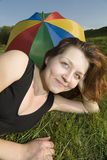 On a grass with umbrella Stock Image