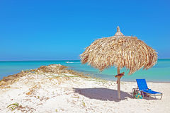 Grass umbrella at the beach on Aruba Royalty Free Stock Photos