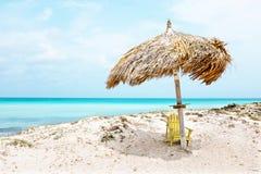 Grass umbrella at the beach on Aruba island Stock Image