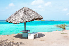 Grass umbrella at the beach on Aruba island Royalty Free Stock Images