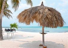 Grass umbrella at the beach on Aruba island Royalty Free Stock Photography