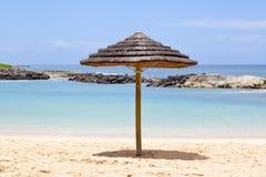 Grass umbrella at Ko'Olina Lagoon Royalty Free Stock Image