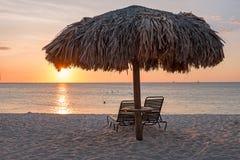 Grass umbrellas at the beach on Aruba island Stock Images