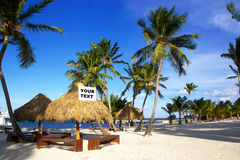 Grass umbrellas  on caribbean beach Stock Image