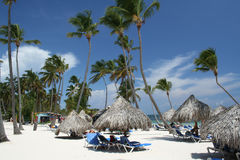 Grass umbrellas at tropical beach resort. Travel, Vacation & Hospitality Collection Royalty Free Stock Images