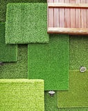 Grass wall. Background made of artificial turf Stock Photography