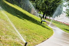 Grass watering Royalty Free Stock Image