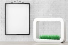 Grass in White Ceramics Planter in front of Brick Wall with Blan Royalty Free Stock Photo