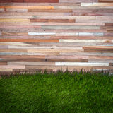 Grass and wood wall, natural background Stock Photos