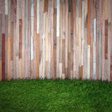 Grass and wooden wall. Natural background royalty free stock image