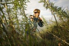Through grass. XL size. Woman hiker resting in grass. XL size Stock Photos