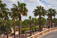 Grasse, Provence, France: view of the garden in the city centre. Grasse, Provence, France: view of the garden and the palm trees in the city centre royalty free stock photography