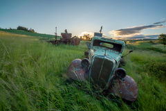 Grasses blow in the wind with rusted old farm truck Royalty Free Stock Photos
