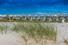 Grasses and Dunes with Row of Beach Houses Stock Photo