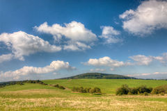 Grassfield and blue sky with clouds. Beautiful summer countryside with grassfield under blue sky with clouds - Czech Republic, Europe Stock Photography